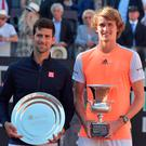 Smiling through: Djokovic (left) alongside his conqueror Alexander Zverev of Germany in Rome yesterday