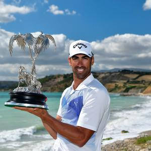 Roc star: Alvaro Quiros with Rocco Forte Open trophy