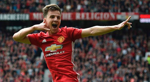 Delight: Josh Harrop enjoys the moment after his opener