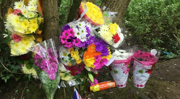 Floral tributes left off Caitlin White
