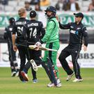 Through the exit door: New Zealand celebrate as Ireland's William Porterfield departs the scene