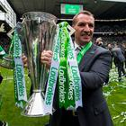 Crowning glory: Brendan Rodgers lifts the Scottish League trophy yesterday
