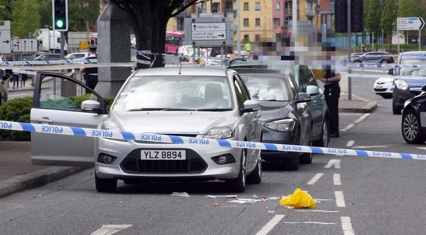 Police at the scene on the Albertbridge Road after an elderly man was knocked down