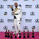 LAS VEGAS, NV - MAY 21: Rapper Drake poses in the press room with his awards for Top Artist, Top Male Artist, Top Billboard 200 Artist, Top Billboard 200 Album for 'Views,' Top Hot 100 Artist, Top Song Sales Artist, Top Streaming Artist, Top Streaming Song (Audio) for 'One Dance,' Top R&B Song for 'One Dance,' Top R&B Collaboration for 'One Dance,' Top Rap Artist, Top Rap Album for 'Views,' and Top Rap Tour during the 2017 Billboard Music Awards at T-Mobile Arena on May 21, 2017 in Las Vegas, Nevada. (Photo by David Becker/Getty Images)