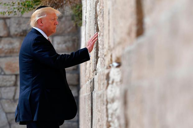 TOPSHOT - US President Donald Trump visits the Western Wall, the holiest site where Jews can pray, in Jerusalems Old City on May 22, 2017. / AFP PHOTO / MANDEL NGAN (Photo credit should read MANDEL NGAN/AFP/Getty Images)