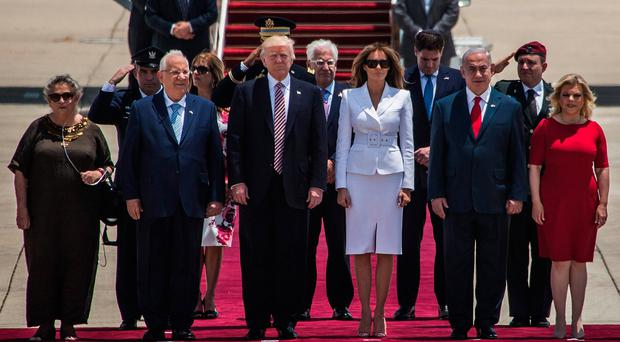 US President Donald Trump and his wife Melania Trump surrounded by Israeli Prime Minister Benjamin Netanyahu and his wife Sara Netanyahu (R) as Israeli President Reuven Rivlin and his wife Nehama Rivlin (L) during an official welcoming ceremony on his arrival at Ben Gurion International Airport on May 22, 2017 near Tel Aviv, Israel. This will be Trump's first visit as President to the region, and his itinerary will include meetings with the Palestinian and Israeli leaders. (Photo by Ilia Yefimovich/Getty Images)