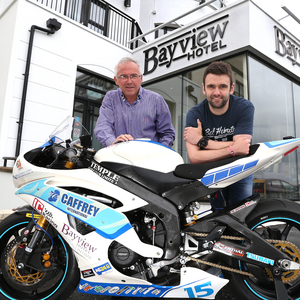 Checking in: William Dunlop with Bayview Hotel proprietor Trevor Kane and the R6 IC Racing/Caffrey Yamaha. Photo Stephen Davison