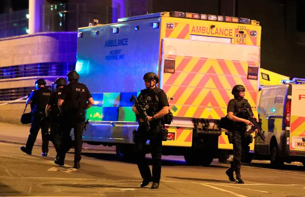 Armed police at Manchester Arena after reports of an explosion at the venue during an Ariana Grande gig. Photo credit should read: Peter Byrne/PA Wire