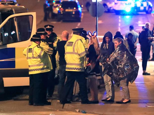 Emergency services at Manchester Arena after reports of an explosion at the venue during an Ariana Grande gig. Peter Byrne/PA Wire