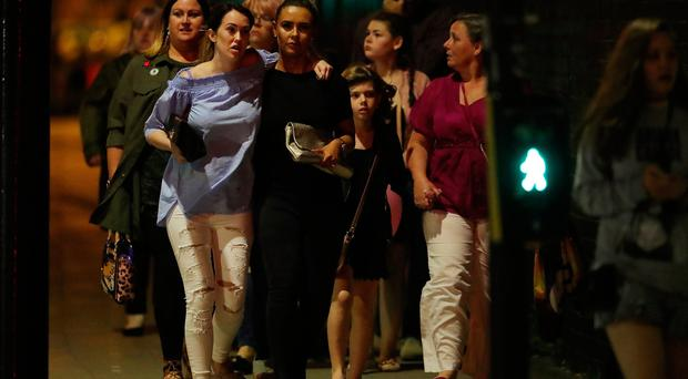 Police escort members of the public from the Manchester Arena on May 23, 2017 in Manchester, England. An explosion occurred at Manchester Arena as concert goers were leaving the venue after Ariana Grande had performed. Greater Manchester Police have have confirmed 19 fatalities and at least 50 injured. (Photo by Christopher Furlong/Getty Images)