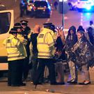Emergency services at Manchester Arena after reports of an explosion at the venue during an Ariana Grande gig. PRESS ASSOCIATION Photo. Picture date: Tuesday May 23, 2017. See PA story POLICE Explosion. Photo credit should read: Peter Byrne/PA Wire