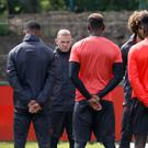 Manchester United's Wayne Rooney stands alongside team-mates for a minute silence in memory of the victims of the Manchester terror attack during the training session at the AON Training Complex in Carrington, ahead of the Europa League Final against Ajax tomorrow evening.