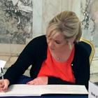 Sinn Fein leader in Northern Ireland Michelle O'Neill signs a book of condolence for Manchester victims at Belfast City Hall. Michael McHugh/PA Wire