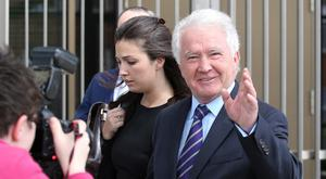 Former Anglo Bank Chairman, Sean Fitzpatrick pictured with his daughter Sarah outside the Criminal Courts of Justice after he was acquitted of all charges. [Photo: Damien Eagers for the Irish Independent 23/05/17]
