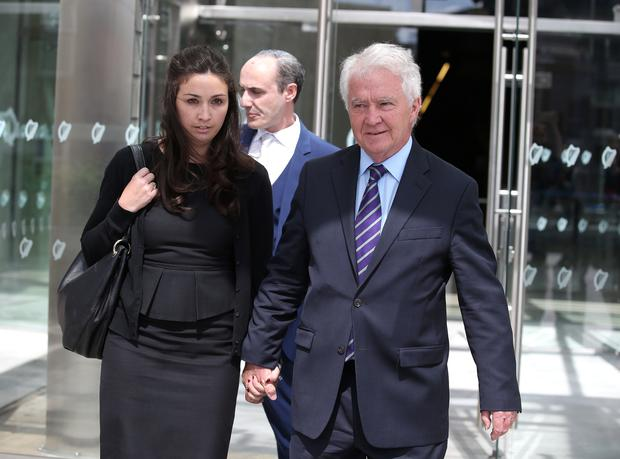 Former Anglo Bank Chairman, Sean Fitzpatrick with his daughter Sarah, after he was aquitted of all charges outside the Criminal Courts of Justice. [Damien Eagers for Irish Independent]