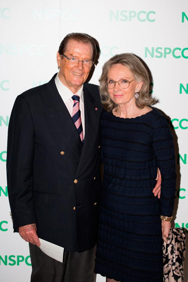 File photo dated 01/10/14 of Sir Roger Moore and his wife Kristina. Sir Roger has died in Switzerland after a short battle with cancer, his family has announced. : Daniel Leal-Olivas/PA Wire