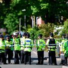 Police officers stand on duty on a cordoned-off road in Fallowfield, Manchester, for search of home. / AFP PHOTO / Oli SCARFFOLI SCARFF/AFP/Getty Images