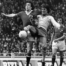 In action: Sammy McIlroy (left) in the 1976 FA Cup final up against Southampton's Jim McCalliog