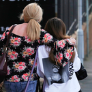 A fan is comforted as she leaves a hotel in Manchester