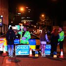 Police near the scene of the blast on Monday night in Manchester