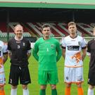 Glentoran players model the white Cougar shirt that the team will wear against Detroit City and a limited edition black shirt, modelled on the jersey worn by the Detroit Cougars in 1967. Gearing up for the trip are Conal Delaney, Curtis Allen, Ross Redman, Elliott Morris, Daniel Kelly, Corey McMullan and John McGuigan.