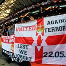 Manchester United fans put up a flag in memory of the victims of the Manchester Concert attack during the UEFA Europa League Final between Ajax and Manchester United at Friends Arena on May 24, 2017 in Stockholm, Sweden. (Photo by Mike Hewitt/Getty Images)