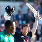 Man of the moment: Eoin Morgan celebrates his ton in the victory against South Africa