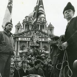 Sammy Wilson and Reg Empey burying democracy in Northern Ireland at the Anti-Anglo-Irish Agreement Rally, Belfast City Hall 1986. The photograph features in a new exhibition at the Ulster Museum called Conflicting Images: Photography during the Northern Irish Troubles - a major exhibition based on National Museums NIs Historic Photographic Collections, looking at the role photography played during The Troubles, and how photography itself changed and developed during these years of conflict.