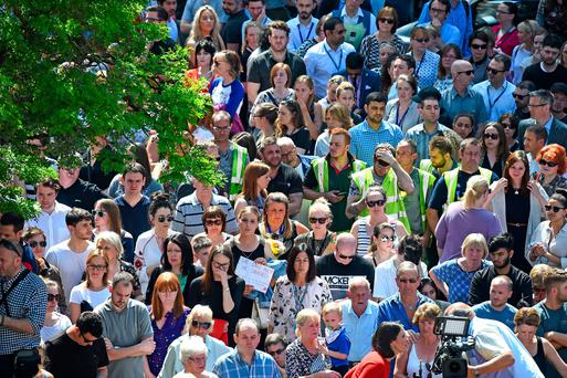 Members of the public observe a national minute's silence in remembrance of all those who lost their lives in the Manchester Arena attack. (Photo by Jeff J Mitchell/Getty Images)