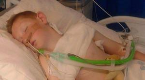 Cameron Dickson (9) on a ventilator.