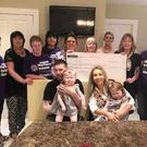 Katie O'Neill, with her sister Evie, mum Roisin and dad Eunan. The family recently handed over a cheque to the NI Children's Hospice following an Afternoon Tea held in Ardboe by Eunan's mum (pictured far left) and members of the Coyle family.