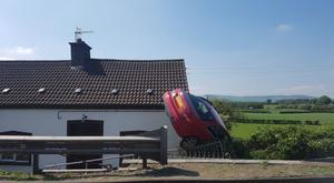 The car upended at the side of a house. Pic: BBC