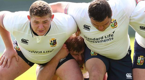 Dark arts: Tadhg Furlong, Jamie George and Iain Henderson get in some scrum practice ahead of Monday's departure