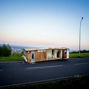 A caravan fly-tipped on the Upper Springfield Road in West Belfast on May 25th 2017 (Photo - Kevin Scott / Belfast Telegraph)