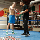 All smiles: Michael Conlan with his coach Manny Robles in America