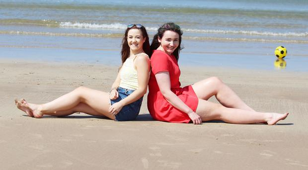 Students Amy Gallagher and Claire Beattie soak up the sun at Portrstewart Strand Beach. PICTURE MARK JAMIESON.
