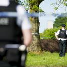 Police officers at the scene of a double murder in the Upper Ramone Park. (Photo - Kevin Scott / Belfast Telegraph)
