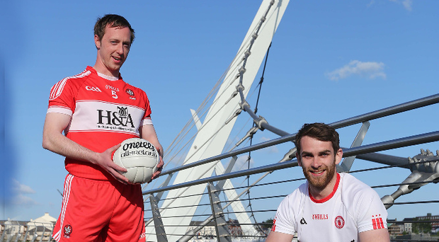 Bring it on: Derry's Neil Forrester (left) and Tyrone's Ronan McNamee with the Anglo Celt Cup ahead of tomorrow's big Championship clash at Celtic Park