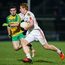 Real deal: Tyrone's Peter Harte (right) has his feet firmly on the ground as he focuses on tomorrow's confrontation with Derry