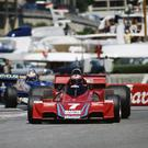 On track: John Watson during the '77 Monaco GP and (left) the 71-year-old still keeps an eye on the world of racing