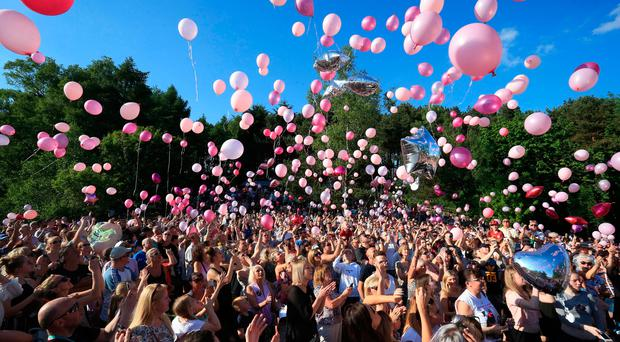 Attendees at a vigil release thousands of balloons into the sky to commemorate the victims of the Manchester Arena bombing