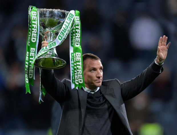 Big lift: Brendan Rodgers shows off the League Cup after defeating Aberdeen in the final