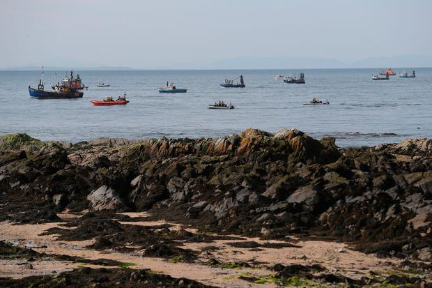 Various vessels including the Irish coast guard in Skerries harbour, as a search and rescue operation got under way. PA