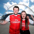 Arsenal fans Paul and Hayley from Leicester in front of the stadium during the Emirates FA Cup Final at Wembley Stadium, London. PA