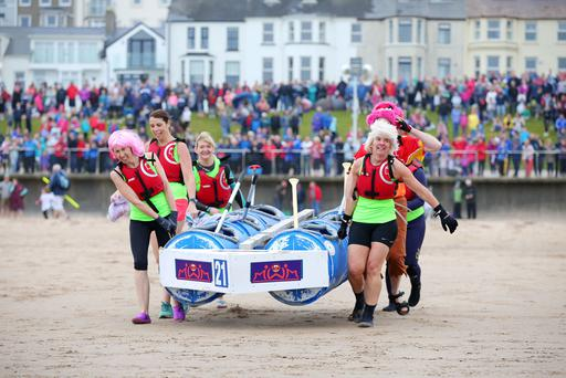 Competitors take part in the annual Portrush Raft Race at the Harbour in Portrush, County Antrim in aid of he RNLI. Photo: Press Eye