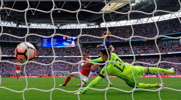 Arsenal's Aaron Ramsey scores his side's second goal of the game during the Emirates FA Cup Final at Wembley Stadium, London. Photo credit: Nick Potts/PA Wire.
