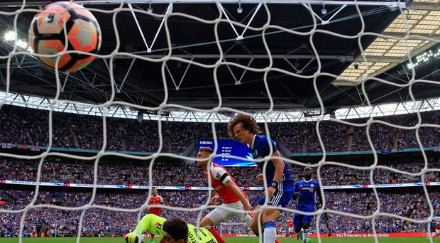 Arsenal's Aaron Ramsey scores his side's second goal of the game during the Emirates FA Cup Final at Wembley Stadium, London. Picture: Nick Potts/PA Wire.
