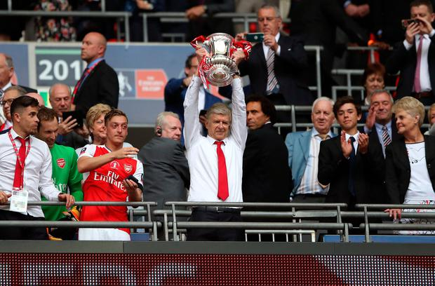 Arsenal manager Arsene Wenger lifts the FA Cup trophy after the final whistle during the Emirates FA Cup Final at Wembley Stadium, London. Nick Potts/PA Wire.