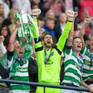 History bhoys: Scott Brown lifts the Scottish Cup at Hampden