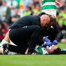 Celtic's Kieran Tierney receives treatment for a facial injury before being substituted during the William Hill Scottish Cup final at Hampden Park on Saturday